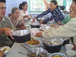 Eating solar cooked food in Vietnam