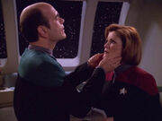 The Doctor examines Janeway