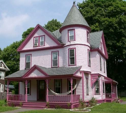 Old-architecture-design-pink-Victorian-house-with-green-garden