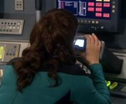 Deanna Troi with scope
