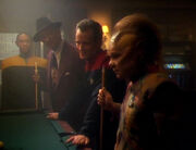 Neelix plays pool with Tuvok