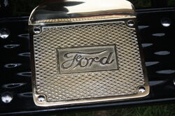 Ford logo on brass step
