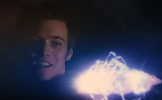 Jake Abel as Luke holding the LB