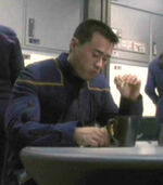 Command ensign eating in mess hall