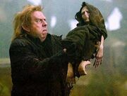 Peter Pettigrew holding Voldemort&#39;s rudimentary body