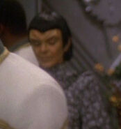 Female Romulan at conference