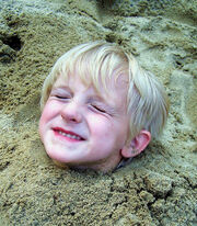 Free Child Buried in The Sand Creative Commons