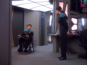 Bashir and Dax discussing Melora's wheelchair
