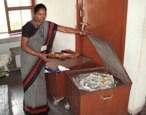 Barli Institute student demonstrates heat retention cooking box.jpg