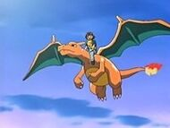 EP412 Charizard volando con ash y pikachu