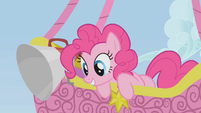 Pinkie Pie looks at Spike who is climbing the rope S1E13