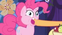 Applejack stuffs an apple into Pinkie's mouth S1E01