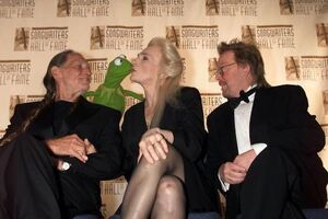 Judy Collins kisses Kermit Songwriters Hall of Fame