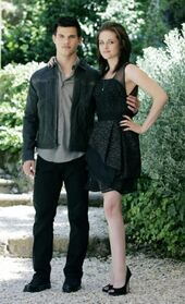 Taylor-Lautner-and-Kristen-Stewart-in-a-Stunning-Black-Cocktail-Dress-for-Twight-Eclipse-Photo-Call feature article horizontal