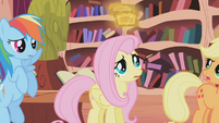 Fluttershy looking at the tickets S01E03