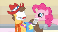 Pinkie Pie shows Applejack's picture to Caramel S1E14