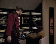 Riker and La Forge look at the probe