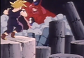 Gohan feeling to his knees aftering being punched by giant hatchyack