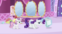 Rarity putting newspaper back in saddlebag S2E23