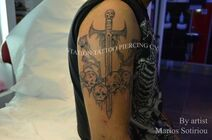 Tattoo skulls and dagger, arm,shoulder,black and g