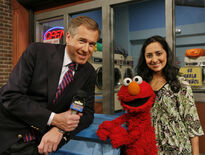 Leela, Brian Williams and Elmo