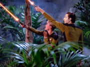 Yar and Data fire phasers