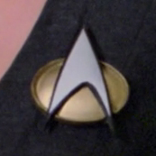 Starfleet combadge, 2364