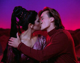Troi and Miller kiss