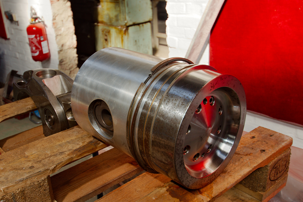 ... piston is the cylindrical component (top). The hole through the piston