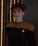 Female DS9 officer watching Quark