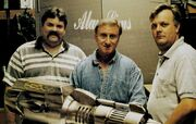 Steve Horch posing with Alan Sims and Michael Moore with the Warhead model