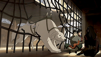 Naga freeing Asami, Bolin, and Iroh
