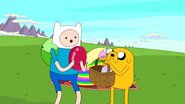 S5 e4 Finn holding disc with Jake holding basket
