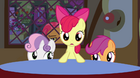 Apple Bloom standing at the table S3E4