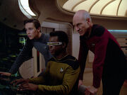 Picard Wesley and La Forge looking at LCARS display