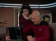 Troi and Picard read Hotel Royale
