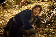 Bilbo in Smaug's treasure