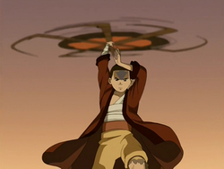 Aang spins his staff