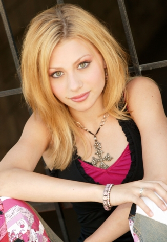 with pretty hazel eyes and shoulder length layered brownish blonde hair.